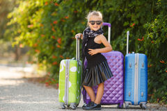 Beautiful young lady travelling with a suitcase Stock Photos