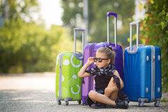 Beautiful young lady travelling with a suitcase Royalty Free Stock Photos