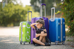 Beautiful young lady travelling with a suitcase Stock Image