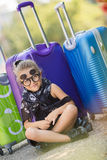 Beautiful young lady travelling with a suitcase Stock Images