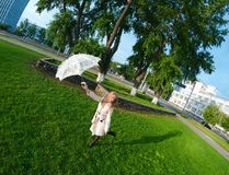 Beautiful young lady with umbrella Royalty Free Stock Photos