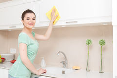 Beautiful young lady washing kitchen Royalty Free Stock Images