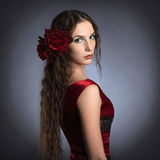 Beautiful young lady wearing red rose dress Royalty Free Stock Photo