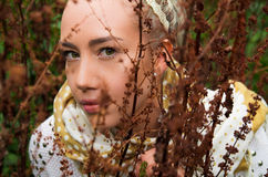 Beautiful young latin girl behind some forest weeds. Close up shot of beautiful young latin girl behind some forest weeds Stock Photos