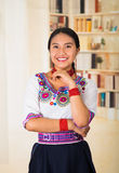 Beautiful young lawyer wearing black skirt, traditional andean blouse with necklace, standing posing for camera, smiling Stock Photos