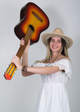 Beautiful young leggy blond Country girl in a litl white dress and cowboy hat with a guitar Stock Photos