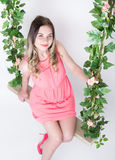 Beautiful young leggy blonde in a little pink dress  Stock Images
