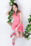 Beautiful young leggy blonde in a little pink dress  Stock Image