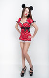 Beautiful young leggy brunette in a very short red dress with white polka dots on the legs black high-heeled shoes. full. Height Stock Photo