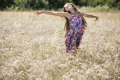 Beautiful young little girl running summer field Royalty Free Stock Image