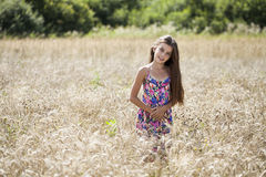 Beautiful young little girl running summer field Stock Photo