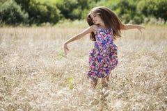 Beautiful young little girl running summer field Stock Photos