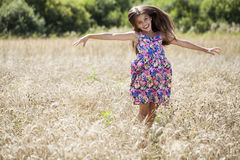 Beautiful young little girl running summer field Royalty Free Stock Photos