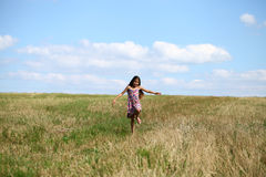 Beautiful young little girl running summer field Royalty Free Stock Photography