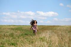 Beautiful young little girl running summer field Stock Photography