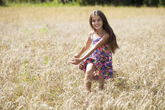 Beautiful young little girl running summer field Royalty Free Stock Images