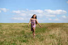 Beautiful young little girl running summer field Royalty Free Stock Photo