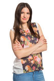 Beautiful young long haired woman with crossed arms. Isolated on white background royalty free stock image