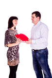 Beautiful young love couple with red heart Royalty Free Stock Images