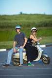 Beautiful young love couple on scooter Stock Image