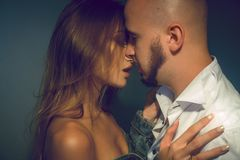Beautiful young lovely couple hugging and kissing in studio royalty free stock images