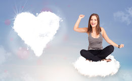 Beautiful lovely woman sitting on cloud with heart Stock Photo