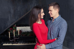 Beautiful young loving couple embraces Stock Photography