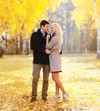 Beautiful young loving couple hugging in sunny autumn Stock Image