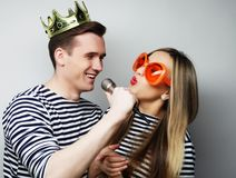 Beautiful young loving couple ready for party. Stock Photos