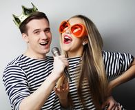 Beautiful young loving couple ready for party. Royalty Free Stock Photography