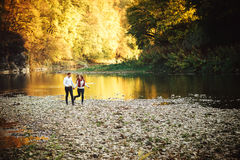 Beautiful young loving couple walking outdoors at the park. Stock Photo