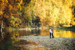Beautiful young loving couple walking outdoors at the park. Stock Photos