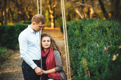 Beautiful young loving couple walking outdoors at the park. Stock Image