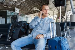 Beautiful young man at the airport Royalty Free Stock Photo