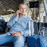 Beautiful young man at the airport Stock Photo