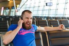 Beautiful young man at the airport Stock Photos