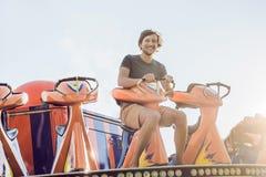 Beautiful, young man having fun at an amusement park.  Stock Photography
