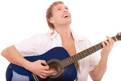 Beautiful young man plays guitar Royalty Free Stock Photos