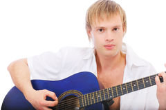Beautiful young man plays guitar Royalty Free Stock Image