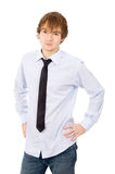 Beautiful young man posing in front of the camera, in a shirt an Royalty Free Stock Photography