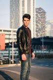 Beautiful young man posing in an urban context Stock Photo