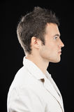 Beautiful young man in profile Royalty Free Stock Photography