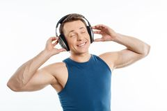 Beautiful young man is relaxing with earphones Royalty Free Stock Photo