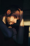 Beautiful young man sad and depressed Stock Image