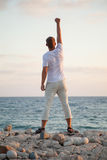 Beautiful young man on the seashore Royalty Free Stock Images