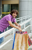 Beautiful young man after shopping. Outdoor shot Royalty Free Stock Photography