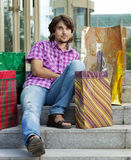 Beautiful young man after shopping. Outdoor shot Stock Photo
