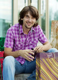 Beautiful young man after shopping. Outdoor shot Royalty Free Stock Image