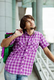 Beautiful young man after shopping. Outdoor shot Royalty Free Stock Photo