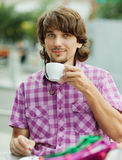 Beautiful young man after shopping Royalty Free Stock Photo